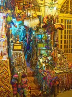 The entrance to the antique souvenir stall of Vakil Bazaar is surrounded by large heaps of different goods-shoes, jewelries, bags, and others. Фото efesenko-Deposit