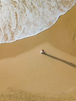 Израиль. Ашдод. Aerial view of young woman standing on sandy beach in front of wavy sea, Ashdod, Israel. Фото VeronikaGorBO - Depositphotos