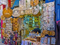 Израиль. Иерусалим. The market stall in Arab Bazaar with the wide range of the wooden, pearl and porcelain souvenirs and talismans, Jerusalem. Фото efesenko-Deposit