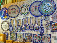 Израиль. Иерусалим. The traditional local wall hangings for kitchen in market stall of Jerusalem, Israel.-angel stained glass window hangings. Фото efesenko-Deposit