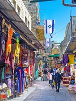 At least a half of the streets of the old walled city are occupied by the traditional eastern markets with wide range of the goods in Jerusalem. Фото efesenko-Deposit
