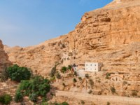 George Orthodox Monastery is located in Wadi Qelt. The sixth-century cliff-hanging complex, is still inhabited. Фото Jukov-Depositphotos