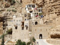 Израиль. Монастырь святого Георгия. Greek Christian orthodox monastery of St. George, along the canyon of Wadi-Qelt, Israel. Фото ajlber-Depositphotos