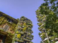 Bosco Verticale is a pair of two upscale residential towers in Milans Porta Nuova district consisting of hundreds of trees and plants in the balconies. Depositphotos