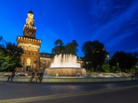 Main entrance to the Sforza Castle and tower-Castello Sforzesco illuminated day to nigh transition timelapse, Milan, Italy. Фото neiezhmakov-Depositphotos