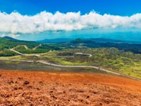 Италия. Сицилия. Катания. Picturesque landscape, lava hills covered with grass and forest. View from The Mount Etna, Sicily, Italy. Фото RS.photography-Deposit