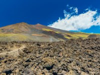 Италия. Сицилия. Катания. Mount Etna with blue sky on the background. Blooming lava hills and field with volcanic stones. Sicily, Italy. Фото RS.photography-Deposit