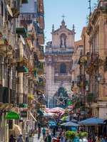 Италия. Сицилия. Катания. The picturesque Via Pacini in Catania, with the Sanctuary of the Madonna del Carmine in the background. Фото e55evu - Depositphotos