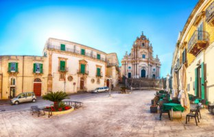 The baroque Saint George cathedral of Modica and Duomo square. Historic center builded in late Baroque Style. Ragusa, Sicily, Italy, Europe. Фото Pilat666-Deposit