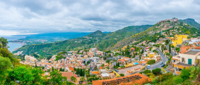 Италия. Сицилия. Таормина. Aerial view of Castelmola village and Taormina town, Sicily, Italy. Фото Dudlajzov - Depositphotos