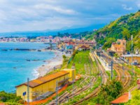 Италия. Сицилия. Таормина. Aerial view of train station in Taormina, Sicily, Italy. Фото Dudlajzov - Depositphotos
