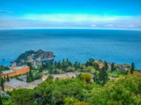 Италия. Сицилия. Таормина. Aerial view of coastline near sicilian city Taormina, Italy. Фото Dudlajzov - Depositphotos