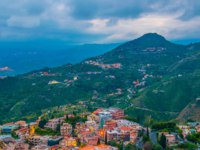 Италия. Сицилия. Таормина. Aerial view of Taormina during sunset, Sicily, Italy. Фото Dudlajzov - Depositphotos