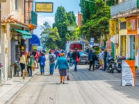 Италия. Сицилия. Таормина. People are strolling on a narrow street in Taormina, Sicily, Italy. Фото Dudlajzov - Depositphotos