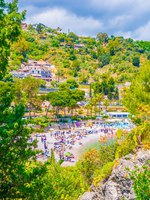 Италия. Сицилия. Таормина. View of a beach near Isola Bella in Taormina, Sicily, Italy. Фото Dudlajzov - Depositphotos