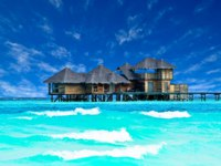 Мальдивы. Gili Lankanfushi Resort, Maldives. Water villa house in Maldives. Фото surangastock - Depositphotos