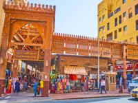 The carved wooden gate of Bur Dubai Grand Souq (bazaar, market) - popular tourist landmark with traditional Arabic goods in Dubai. Фото efesenko - Depositphotos