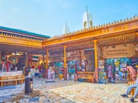 The square in Grand Souq of Deira with fountain, benches and stores, offering different goods in Dubai. UAE. Фото efesenko - Depositphotos