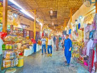 Grand Souq Deira with different stalls, offering exotic spices, local perfumes, colorful clothes, Eastern souvenirs. Фото efesenko - Depositphotos