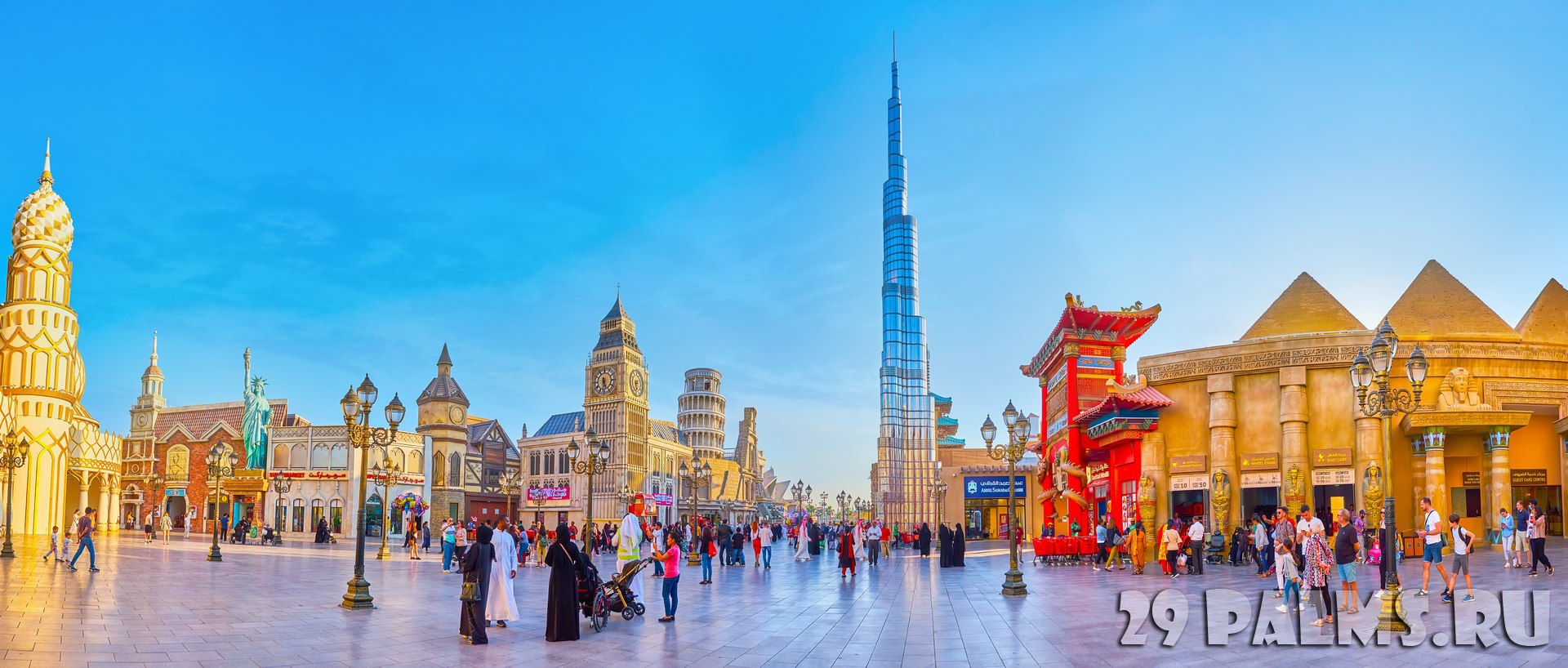 ОАЭ. Дубай. Panorama of crowded Global Village square with replicas of Egyptian temple and Pyramids, Burj Khalifa, US Liberty Statue in Dubai. Фото efesenko-Deposit