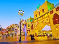 ОАЭ. Дубай. Всемирная деревня. The pavilions of Global Village Dubai are decorated with colored illumination in Dubai. Фото efesenko - Depositphotos