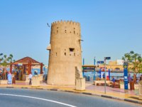 The old adobe watchtower of Bur Dubai historical district is located on the bank of Dubai Creek in Dubai. Фото efesenko - Depositphotos
