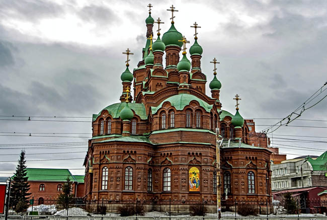 Челябинск. Свято-Троицкая церковь. View of the building of the Holy Trinity Church on Kirov street on a cloudy spring day in Chelyabinsk. Фото valerypetr-Deposit