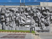Birth of the City - a high relief at retaining wall of the Dam of the city pond. The relief by Peter Sharlaimov. Фото markovskiy - Depositphotos