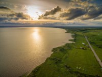 Золотое кольцо России. Переславль-Залесский. Beautiful lake Plescheevo at sunset - aerial view near Pereslavl-Zalessky. Russia. Фото nikitabuida - Depositphotos