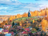 View of the city of Plyos and Mount Levitan with the Resurrection Church from the height of Sobornaya Mountain in an autumn sunny day. Фото yulenochekk-Deposit