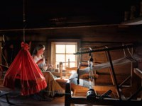 Россия. Карелия. Остров Кижи. Woman in traditional russian costume weaves in Historico-architectural museum Kizhi on Kizhi island, Karelia. Фото Byelikova-Dep