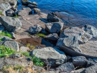 The shore and the bottom of Lake Valaam is formed from rock. The wonderful island Valaam is located on Lake Lodozhskoye, Karelia. Фото GeneralSky-Depositphotos