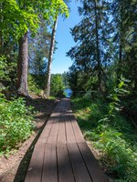 In some places, wooden walkways are laid. The wonderful island Valaam is located on Lake Lodozhskoye, Karelia. Фото GeneralSky-Depositphotos