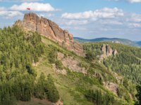 Россия. Красноярские столбы. Reserve Krasnoyarsk Pillars. View on the rocks Takmak and Ermak. Фото tilpich.yandex.ru - Depositphotos