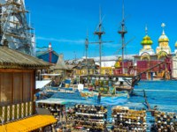 The wooden ship sails in painted timbered sea in the middle of the souvenir Vernissage market in Izmailovo in Moscow. Фото efesenko-Depositphotos