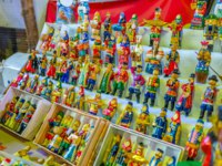 The handmade Christmas toys in vintage costumes in the stall of Izmailovsky market, Moscow, Russia. Фото efesenko-Depositphotos