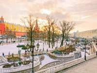 Россия. Москва. Манежная площадь. View of the Alexander Garden near Moscow Kremlin on Manezh Square in winter sunset. Фото marina99-Deposit