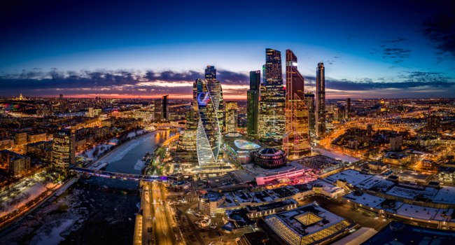 Россия. Москва-сити. The Moscow City skyscrapers are seen during a sunset in Moscow, Russia. Фото dmitry.serebryakov - Depositphotos