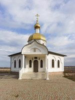 Новороссийск. Platform with a bench at the entrance to the Church is the chapel of the Holy righteous Theodore Ushakov Sunny winter day. Фото Garmashevanatali-Dep