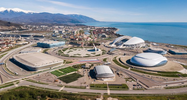 Сочи. Панорама Олимпийского парка. Sochi Olympic Fire Bowl in the Park. Central stella and Stadium Fisht built for Winter Games. Sochi. Фото IvanVislov - Depositphotos