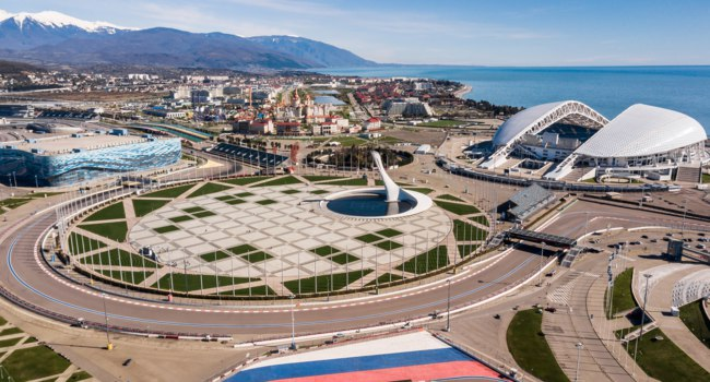 Сочи. Панорама Олимпийского парка. Sochi Olympic Fire Bowl in the Park. Central stella and Stadium Fisht built for Winter Games. Sochi. Фото IvanVislov-Depositphotos