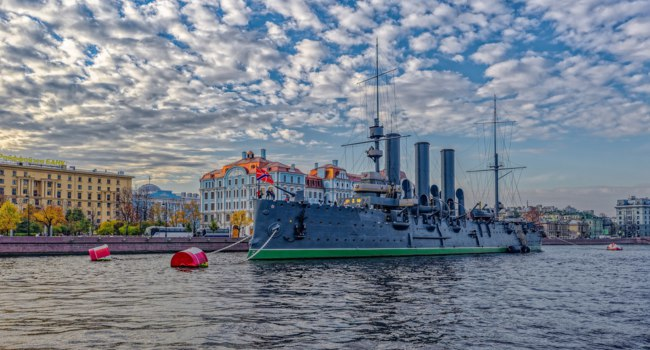 Санкт-Петербург. Крейсер Аврора. The historical cruiser Aurora who took part in the Russian revolution in 1917th. moored on the Neva river. Фото Igor-SPb-Deposit