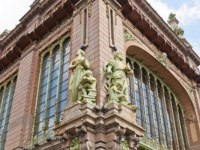 Allegory statues of Science and Industry on the facade of Elisseeff Emporium (circa 1903) in Saint Petersburg. Sculptor Amandus Adamson. Фото joymsk-Depositphotos