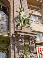 Statue of Hermes (the allegory of Commerce) on the facade of Elisseeff Emporium (circa 1903) in Saint Petersburg. Sculptor Amandus Adamson. Фото joymsk-Deposit