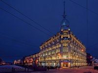 Ornate illuminated for Cristmas and Ney Yeaw celebration historic Esders and Scheefhals building at the embankment of Moika river. Фото Igor-SPb - Depositphotos