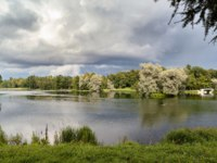 A picturesque view in Gatchina Palace Park on the beautiful nature and architecture. Summer landscape in the Gatchina, St. Petersburg. Фото pantiche - Depositphotos