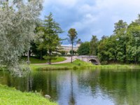 View of the Gatchina Palace from the side of the Palace Park, next to Karpin pond in autumn. St.Petersburg. Фото pantiche@gmail.com - Depositphotos