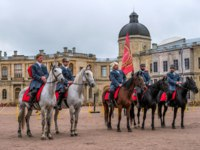 Horse show of Cossacks on the parade ground of the Gatchina Palace on the day of the anniversary of Emperor Paul I. Фото Oktober64 - Depositphotos