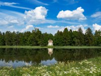 The eagle pavilion in the old Park of Gatchina. Summer minimalistic panoramic landscape with a lake in the Park. Фото sablinstanislav - Depositphotos
