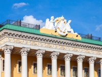 Sculptural composition on the roof of Lobanov-Rostovsky Palace. Building at Admiralteysky Avenue in Saint Petersburg, Russia. Фото blinow61 - Depositphotos